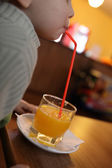 Toddler drinking juice — Stock Photo