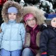 Children with Christmas tree — Stock Photo