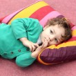 Toddler is lying on carpet — Stock Photo
