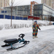 Child with snow scooter — Stockfoto #37758021