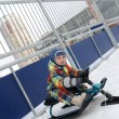 Stock Photo: Kid on snow scooter