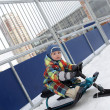 ストック写真: Kid on snow scooter