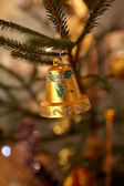 Bell on Christmas tree — Stock Photo