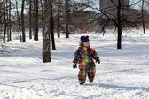 Kid walking in park — Stock Photo