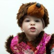 Child in a bear suit — Stock Photo