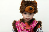 Boy in a bear suit — Stock Photo