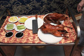 Table with peking duck — Stock Photo