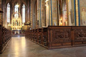 Wooden pew in the cathedral — Stock Photo