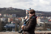 Mother with son looking at Prague — Stock Photo