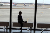 Boy looking at airplane — Stock Photo