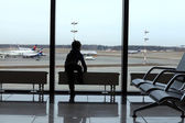 Child looking at airplane — Stock Photo