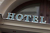 Green hotel sign — Stock Photo