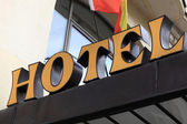 Hotel signboard on the wall — Stock fotografie