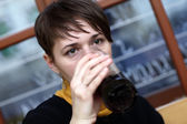 Woman has dark beer — Stock Photo
