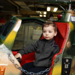 Kid on toy helicopter — Stock Photo