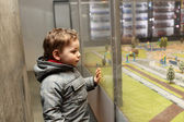 Child looking at toy town — Stock Photo