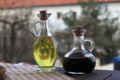 Olive oil with soy sauce carafes — Stock Photo