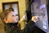 Child using touch screen — Stock Photo