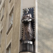 Sculpture of woman on corner of the building — Stock Photo #48626443