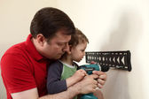 Family working with screwdriver — Stock Photo