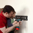 Father with son installing mount TV — Stock Photo #48890801