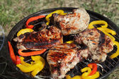 Cooking barbecue pork loin and pepper — Stock Photo