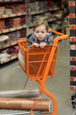 Child in shopping trolley — Stock Photo