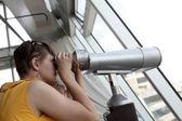 Family looking through pay binoculars — Stock Photo