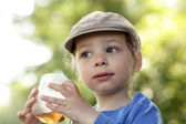 Boy with cup of tea — Stock Photo