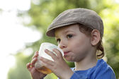 Kid with cup of tea — Stock Photo