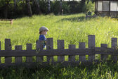 Child and lath fence — Stock Photo