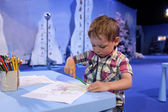 Child drawing in playroom — Stock Photo