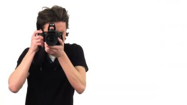 Photographer with camera on white background — Stock Video
