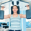 Stock Photo: Woman in fitness club