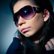 Portrait of a young girl in sunglasses — Stock Photo #21659325