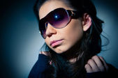 Portrait of a young girl in sunglasses — Stock Photo