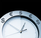 Currency clocks isolated on black — Stock Photo