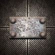 图库照片: Old metal plate on metallic wall