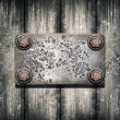 Stock Photo: Old metal plate on metallic wall