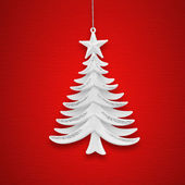 Christmas tree on a background of red paper — Stock Photo
