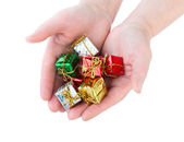 Woman holds many beautiful little Christmas gifts on white backg — Stok fotoğraf