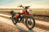 Classic old motorcycle on a dirt road. — Stock Photo