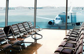 Seats, view from airport hall. Boarding. — Stock Photo
