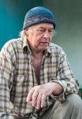 Seniors portrait of contemplative old caucasian man looking down — Stock Photo