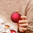 Stock Photo: Christmas ball in hands