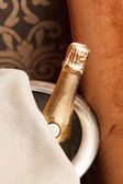 Champagne bottle in bucket — Stock Photo