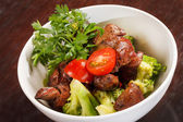 Chicken liver with vegetables — Stock Photo