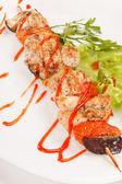 Chicken kebab with tomato sauc — Stock Photo