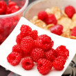 Cornflakes with milk and raspberries - Stock Photo