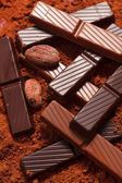Chocolate with cocoa beans — Stock Photo